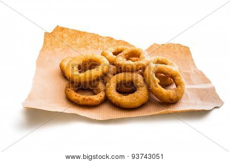 onion rings on parchment isolated on a white background