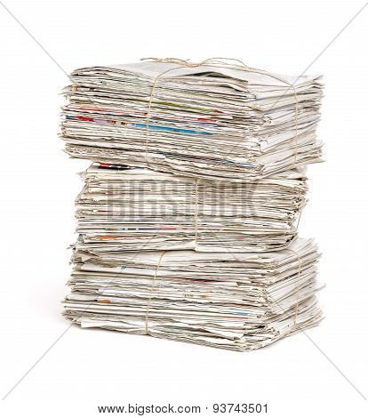 Stacked Newspaper Bundles On A White Background
