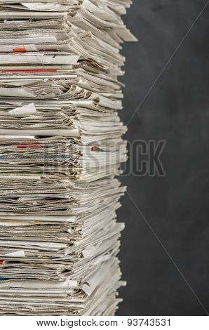 Piled Newspapers On A Dark Background