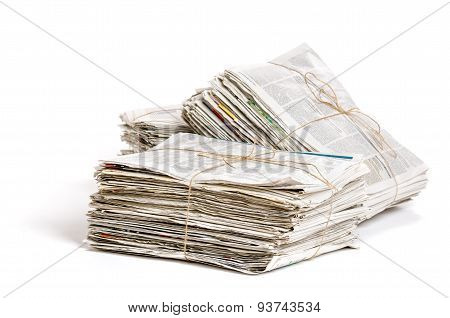 Some Bundles Of Newspapers On A White Background