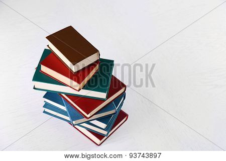 Stack of books on light surface background
