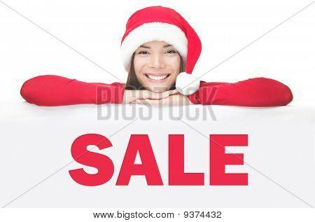 Santa Woman Showing Sale Sign Board