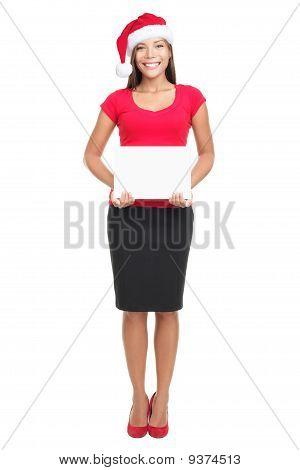 Santa Hat Businesswoman Holding Sign