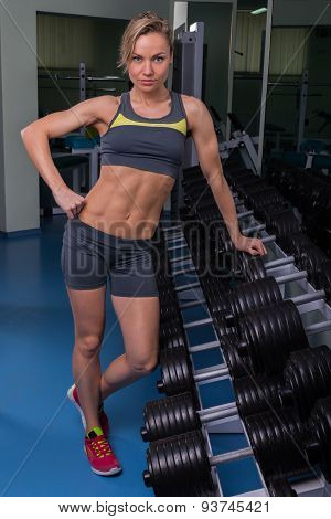 Beautiful, sexy, muscular blonde in the gym. Female fitness.