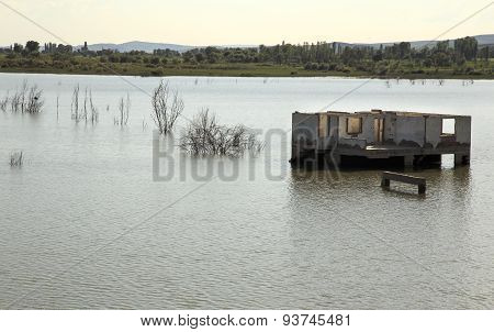 Destroyed House In The Middle Of Lake