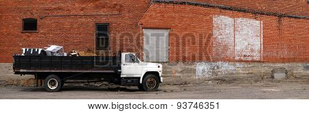 Detail panorama of work truck and brick wall