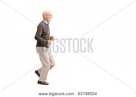 Full length portrait of a senior man in casual clothes running and smiling isolated on white background