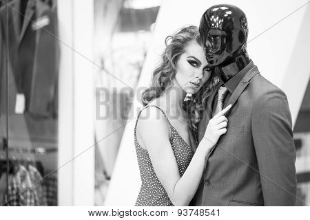 Enigmatic Woman And Mannequin