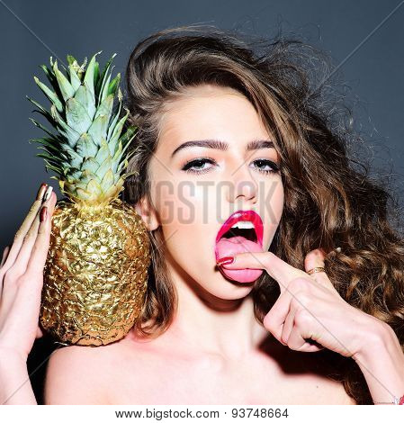 Portrait Of Sexy Young Girl With Golden Pineapple