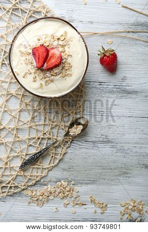 Healthy homemade oatmeal on wooden table, close up
