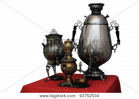 Three Old Russian Samovar On A White Background