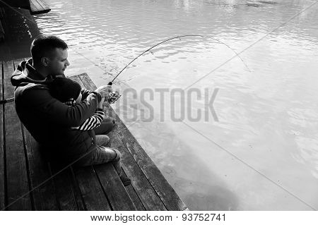 Dad and son on fishing. Family weekend leisure.