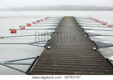 Empty Boat Park On The Lake In Winter Under The Snow