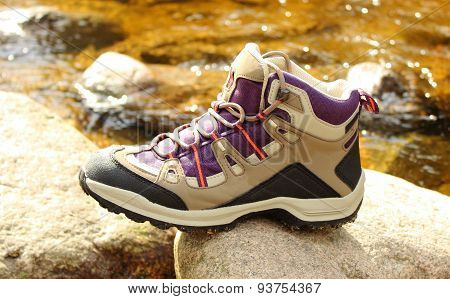 Hiking Boot Over A Mountain Stream