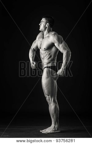 Handsome male bodybuilder. Bodybuilder posing on a black background