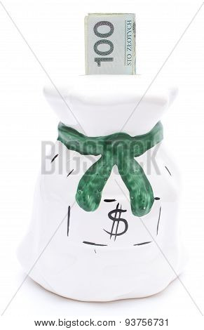 Moneybox And Banknote On White Background