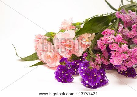 Bouquet Of Carnations And Statice On White Background
