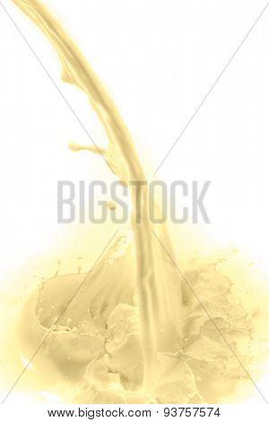 pouring vanilla flavored milk on white background