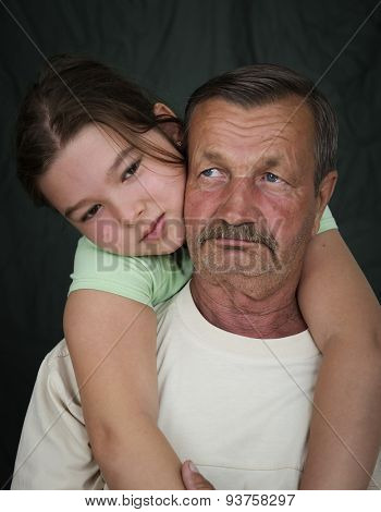 Grandfather and his granddaughter hugging