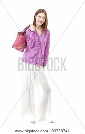 Smiling Woman Wearing Hippie Clothes Holding Bag.