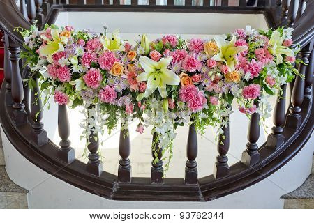 Floral Decorate In Handrail Of Stairs At The Wedding