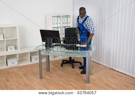 Janitor Cleaning Desk With Cloth