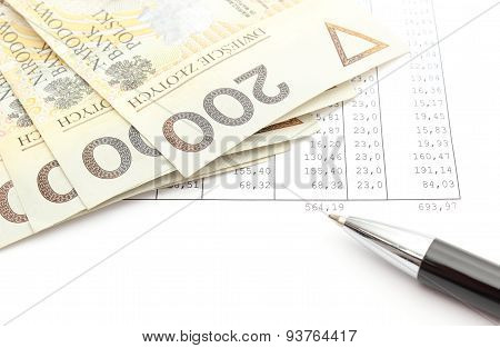 Money And Ballpen Lying On Spreadsheet
