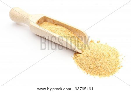 Closeup Of Loose Garlic On Wooden Spoon. White Background