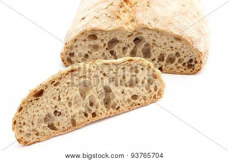 Slice Of Rye Bread And Loaf In Background
