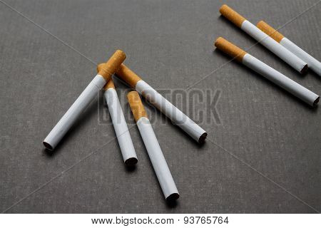 A Few Cigarettes On Dark Background