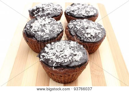 Fresh Baked Chocolate Muffin With Desiccated Coconut On Chopping Board