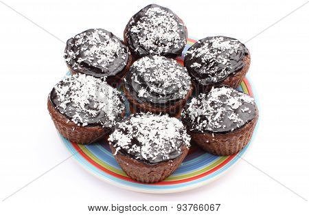 Fresh Baked Chocolate Muffin With Desiccated Coconut On Colorful Plate