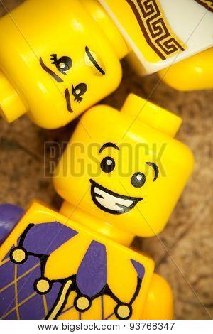 Sofia, Bulgaria - March 15, 2015: Closeup image of plastic minifigures heads