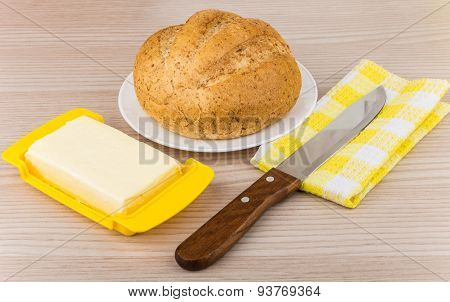 Butter, Bread In Plate And Knife On Napkin