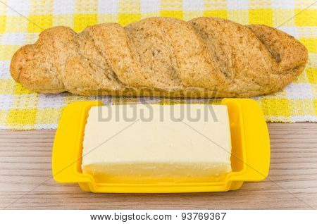 Loaf Of Buckwheat Bread On Napkin And Butter