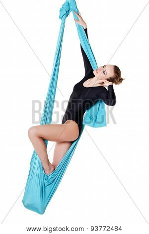 Female Performer Hanging On Aerial Silk