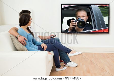 Couple In Livingroom Watching Television