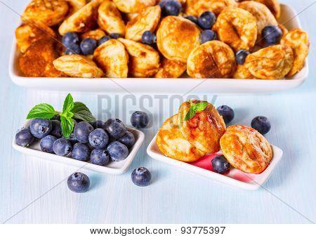Mini pancakes with fresh blueberries