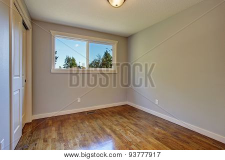 Simplistic Hardwood Bedroom.