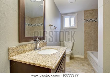 Medium Sized Bathroom With Tile Floor.