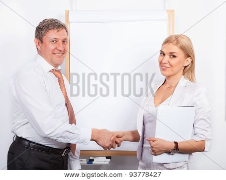 Business colleagues shaking hands in  training class