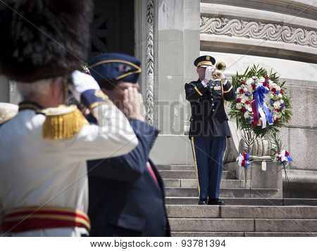 NEW YORK - MAY 25 2015: US Navy personnel is saluted as he plays the trumpet at the conclusion of the Memorial Day Observance service at the Soldiers and Sailors Monument during Fleet Week NY 2015.