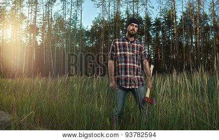 Bearded Lumberjack In Hat Holding A Big Ax In Hand