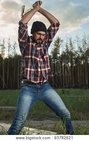 Lumberjack With Beard, Hat And Shirt Swings The Ax