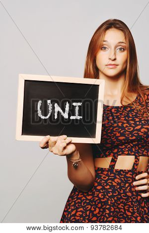 University College Student Holding A Chalkboard Saying Uni