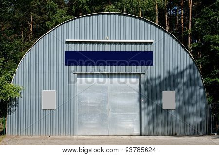 Metal shed in the woods