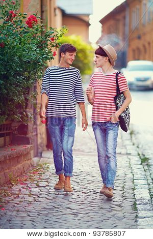 Young Male Couple Walking The City Street