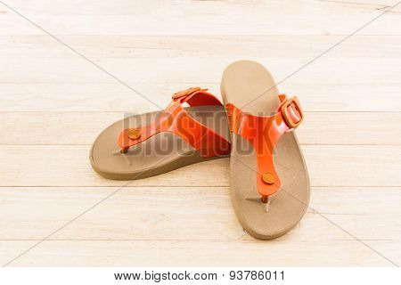 Colorful Of Sandals Shoes On Wood Background.