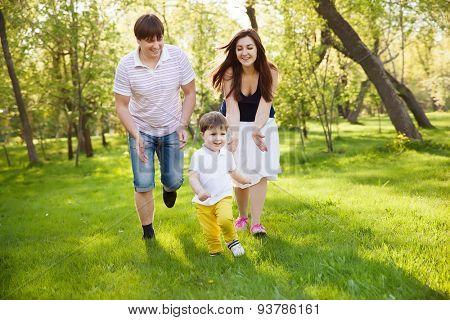 happy family having fun in the park