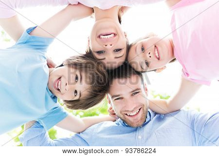 Happy family forming a huddle